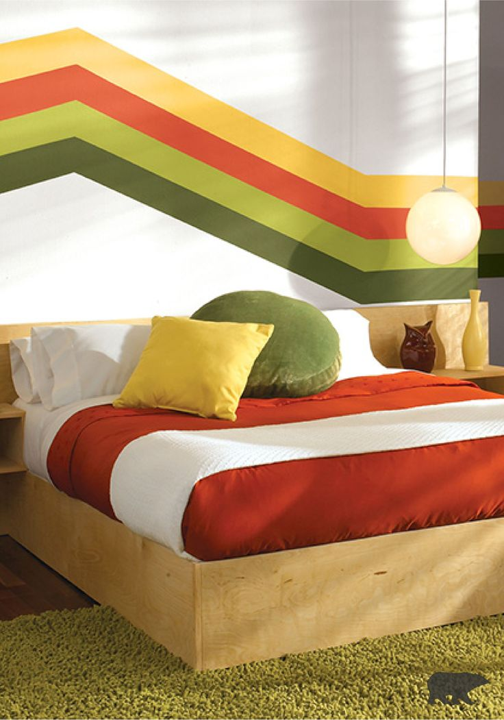 This DIY wall decor inspiration creates the ultimate statement piece for your bedroom—the combination of English Daisy yellow, Inferno red, Green Neon, and Classic Avocado paint truly ties the entire space together. This '70s-inspired room from BEHR can be just the funky style you've been looking for.