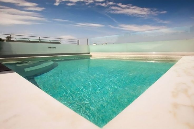 """Charming duplex apartment with generous roof garden and pool near the Golf Club of Gyfada. This 5th-6th floor apartment for sale boasts luxury amenities such as living room with fireplace, roof garden and private swimming pool with jacuzzi, oak and teak wood floors and """"smart house"""" lighting system."""