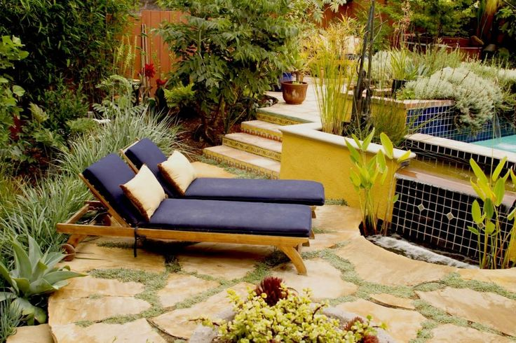 Spanish Tiles are a Great Way to Add Colour to Your Home: Simple Mediterranean Landscape With Spanish Tiles On Outdoor Stairs Surrounded By Greenery Also Dark Blue Chaise Lounges On Flagstone Pavers Then Added By Water Feature ~ flexform.org Design Ideas Inspiration