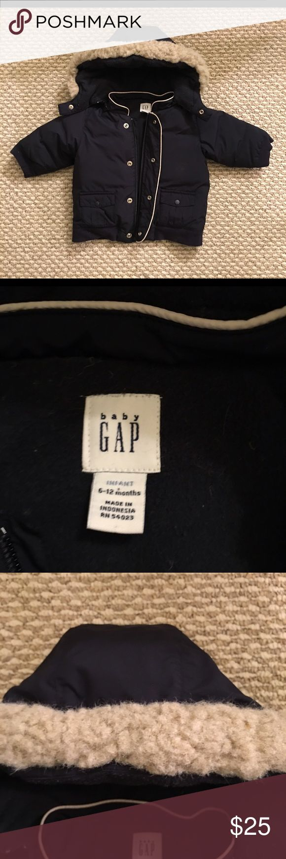 Gap jacket Gap navy blue very warm jacket, perfect for this fall/winter. I wish my little guy still fits it! Pretty good condition, the fur on the hoodie had been washed so it doesn't look like b4. Otherwise the jacket is in perfect condition. GAP Jackets & Coats Puffers