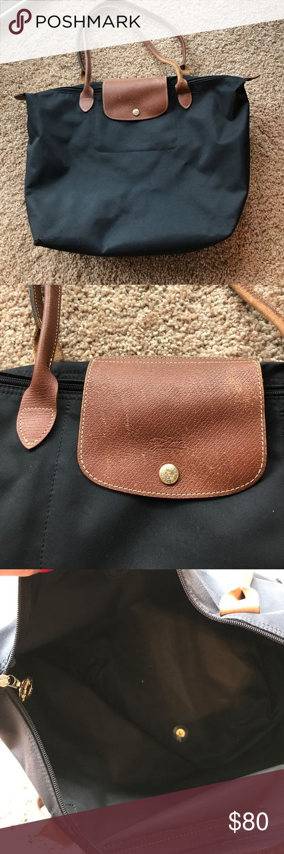 Long Champ Le Pliage Large Purse Gorgeous classic Longchamp purse. This one is large and can hold anything youd need! A couple of tiny holes in the bottom corners and the snap on the back is bent. Other than that, the purse is perfectly functional! Make an offer! Longchamp Bags Totes