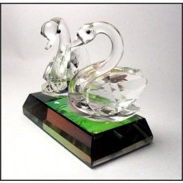 Crystal Bird Ornaments, Pair of Swans  A beautiful ornament, for any special celebration.  This crystal figurine of a pair of swans is a beautifully handmade and skilfully produced ornament.  An original import from Belgium, this stunning piece makes a perfect gift, or a great addition to any collection. All our Boda crystal comes beautifully gift boxed.