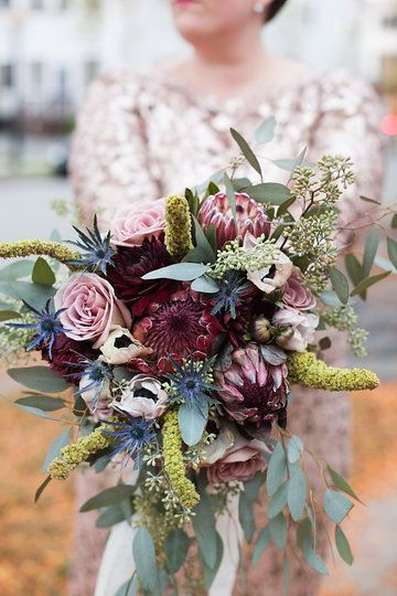 My (Carrie Strine) DIY wedding bouquet thanks to @fiftyflowerscom. Featuring anemones, amnesia roses, antique carnations, thistle, protea, eucalyptus, dahlias, seeded eucalyptus and upright amaranths. Photo by Carey MacArthur Photography