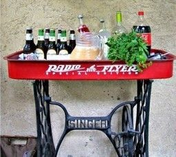 Radio Flyer patio bar.....I JUST tossed this wagon 2 weeks ago....bummer....shop local flea markets for this singer base,,,,they are there by the hundreds!