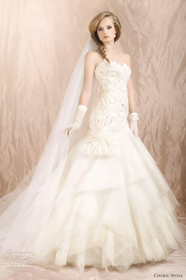 Antea strapless gown with flora bodice and skirt of organza and tulle dotted with Swarovski rhinestones...Cherie Sposa http://www.weddinginspirasi.com/