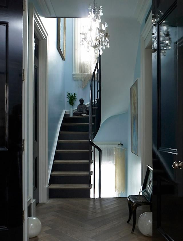 Love the colors and the stairs and the lighting...this is actually Courtney Love's house.