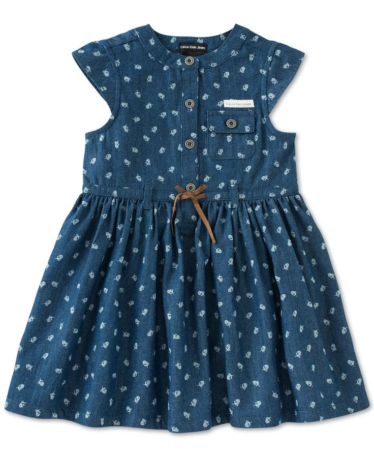 Precious floral print blooms on this adorable Calvin Klein belted denim dress for baby girl.   Denim: cotton; jersey: cotton/polyester   Machine washable   Imported   Crew neck   Short cap sleeves   T