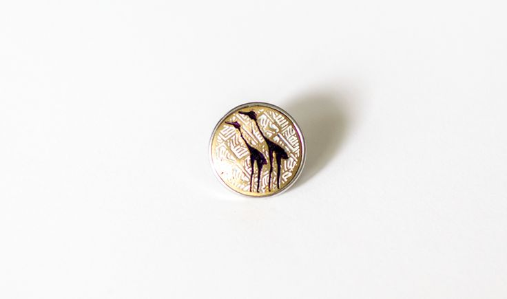 This Mila + Ruby pebble features the national bird of Australia - The Emu. It has a prominent place in Aboriginal mythology whereby it is said that the sun was made by throwing an Emu's egg into the sky.  Made from white, gold and black metal with deco colouring.  Individually handcrafed in Nepal.