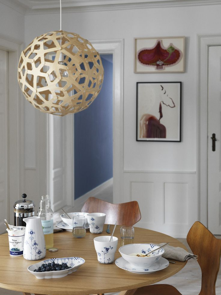 Grand Prix chair by Arne Jacobsen and Royal Copenhagen dinnerware. Whats not to like. Picture from Royal Copenhagen.com