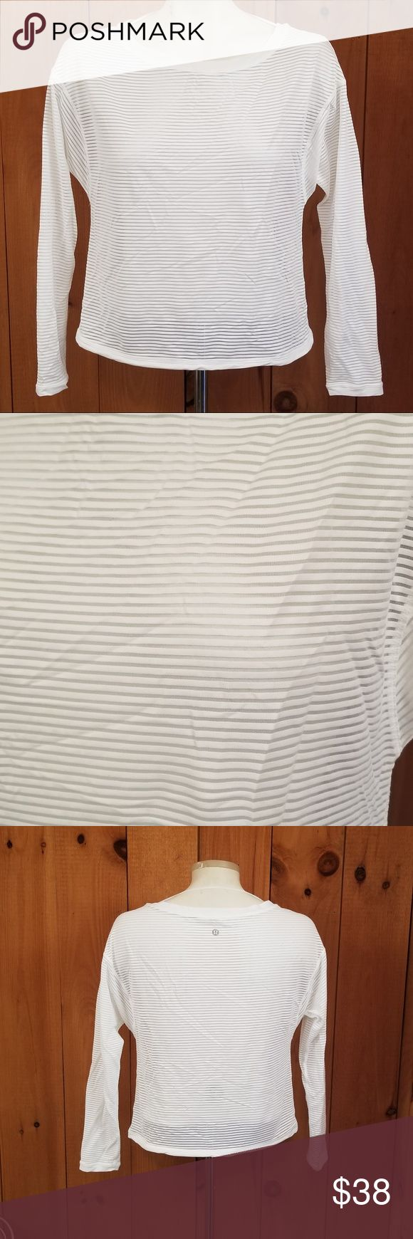 "Lululemon Women's White Stripe Sheer L/S Gym Top Lululemon Women's White Stripe Sheer Long Sleeve Workout Cinch Waist Top Large  17"" chest 18"" underarm to wrist  no size tag we are assuming its a large based on the measurements  made of a lightweight poly material and it is semi sheer with waist drawstrings to cinch the bottom in lululemon Tops"