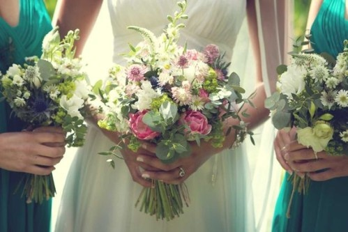 love the different heights of the blooms in the bride's bouquet. would want to achieve similar with yours. wild but not too wild looking.