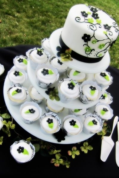 Summer Wedding Cupcakes.. Except with purple instead if green. Beautiful main cake on top, and cupcakes on bottom, with simple flower designs. Lovely.