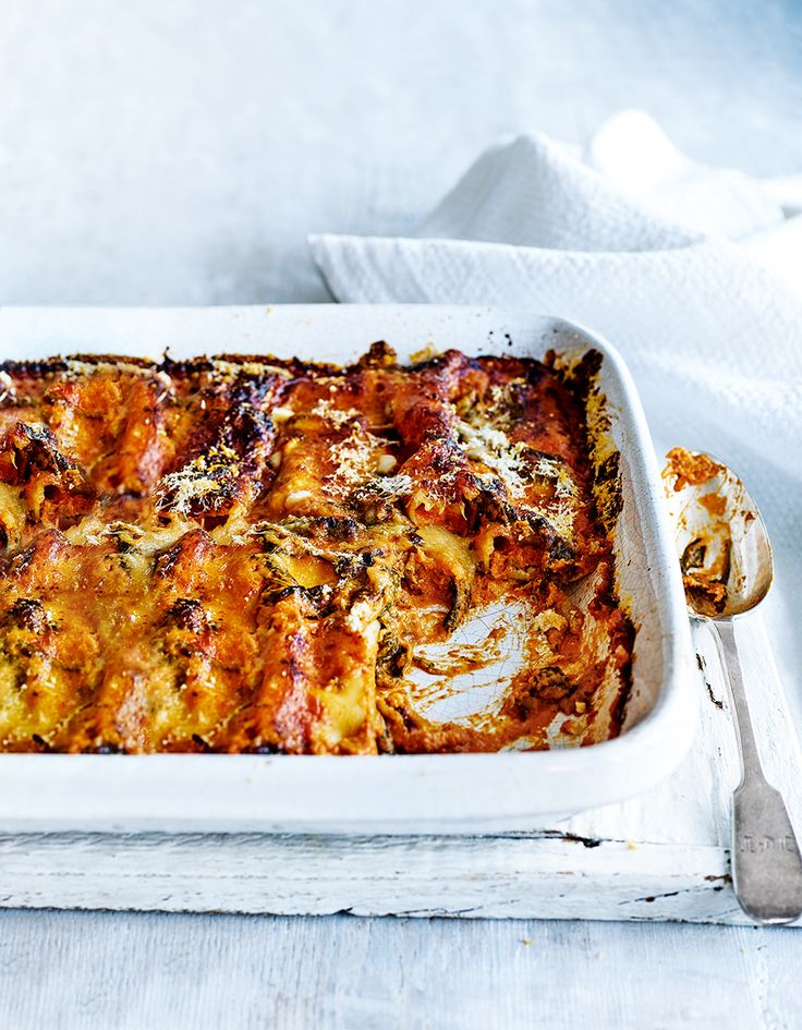 Use up leftover roast chicken in this comforting cannelloni recipe with spinach and ricotta. The recipe for two is quick, easy to make and perfect as a midweek meal.