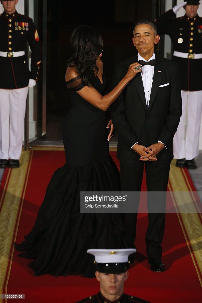 U.S. First Lady Michelle Obama straightens U.S. President Barack Obama's tie while they wait on the North Portico for the arrival of Chinese President Xi Jinping and his wife Madame Peng Liyuan ahead of a state dinner at the White House September 25, 2015 in Washington, DC. Obama and Xi announced an agreement on curbing climate change and an understanding on cyber security.  (Photo by Chip Somodevilla/Getty Images)