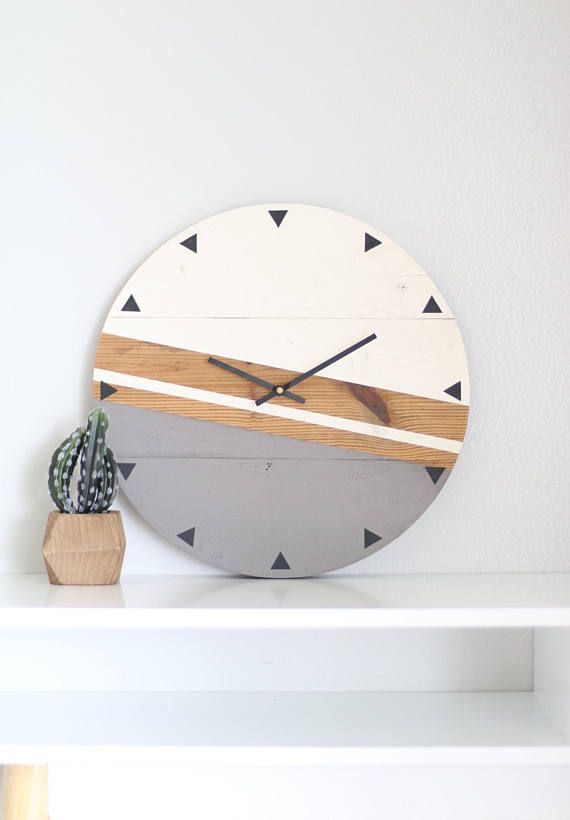 This unique wall clock is handcrafted from start to finish using authentic wood siding locally sourced from barns in Northern Indiana. Each piece of wood is carefully removed from its back side to preserve its condition and natural beauty. The siding may vary in size from 5-7 wide. The clock is fastened in the back with two additional wooden pieces that are securely drilled and screwed in. Once the clock is assembled, we use a professional-grade router to cut a precise circle in the clock…