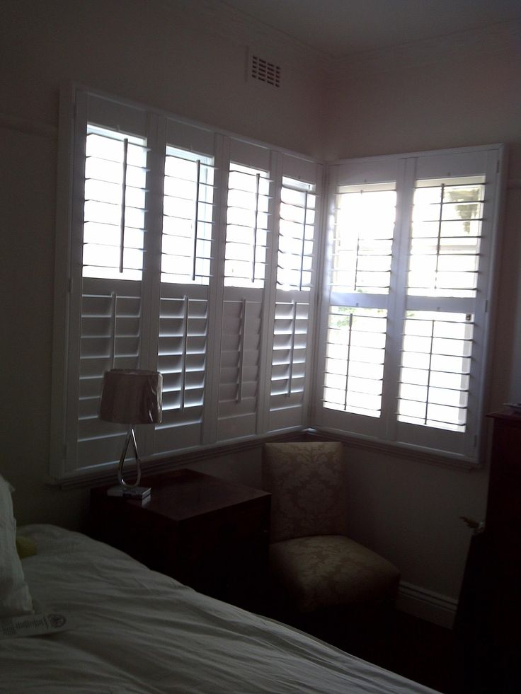 Plantation Shutters with stick control and 89mm blades in a house in Yarraville