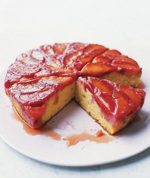 Plum Upside-Down Cake 1/2 cup (1 stick) plus 1 tablespoon unsalted butter, plus extra for the pan, at room temperature 4 firm, ripe plums, each cut into 8 wedges 1/4 cup plus 2/3 cup granulated sugar 1 cup all-purpose flour 3/4 teaspoon baking powder 1/4 teaspoon baking soda 1/4 teaspoon kosher salt 1 large egg 2/3 cup sour cream 1 teaspoon pure vanilla extract