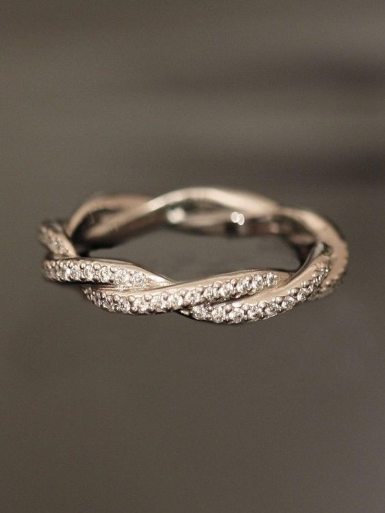 This type of band with rose/white golds entwined...I dream of this band and matching engagement ring!