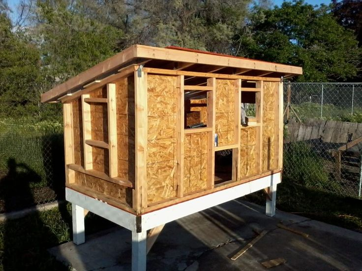 Chicken coop construction. The one we're designing is very similar to this.