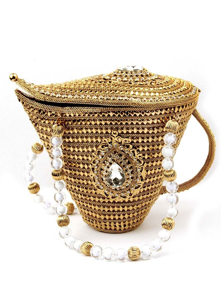 Aesthetic golden color aladdin chirag style potli made of brass metal adorned with glittering crystals and diamantes. Item Code: SJBP2009 http://www.bharatplaza.com/new-arrivals/accessories.html