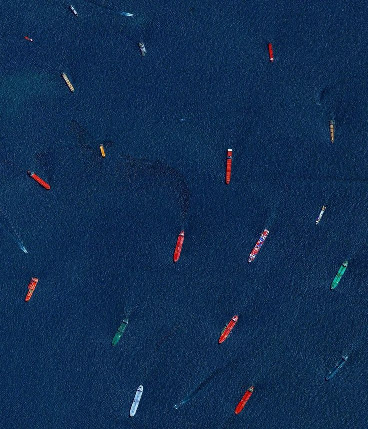 """Cargo ships and oil tankers wait outside the entrance to the Port of Singapore. This is one of my favorites from """"Overview"""" which is on sale right now for only $22.19 on Amazon when you use the coupon code GIFTBOOK17"""" here:  https://www.amazon.com/Overview-Perspective-Earth-Benjamin-Grant/dp/039957865X/ref=zg_bs_3564969011_4  That's 45% off and certainly the lowest price you will find before the holidays! The Port of Singapore is the world's second-busiest port in terms of total tonnage…"""