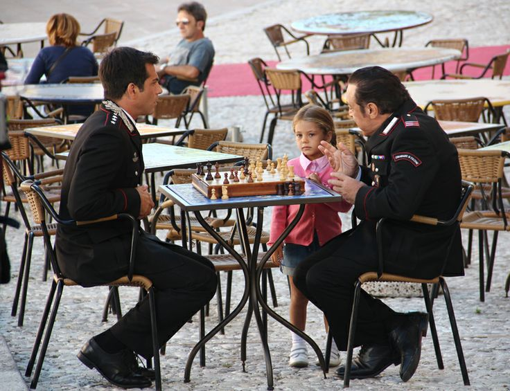 Shooting Don Matteo9 in Spoleto. Captain Guilio Tommasi (Simone Montedoro) and mareciallo Checchini (Nino Frassica) with the captain's daughter Martina (Emma Reale)