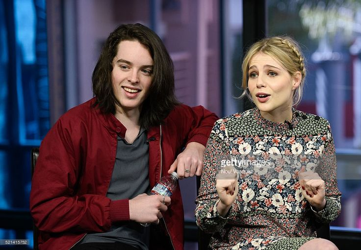 Ferdia Walsh-Peelo (L) and Lucy Boynton visit 'Extra' at Universal Studios Hollywood on April 15, 2016 in Universal City, California.