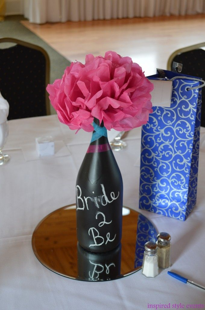 bridal shower centerpieces diy%0A Here is an easy tutorial for DIY Centerpiece Idea for Bridal Shower  Spray  painted wine bottles and tissue paper flowers