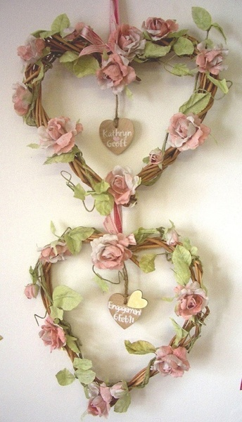 Heart shaped wreath with flowers on vines. Cuddle Me Cozy