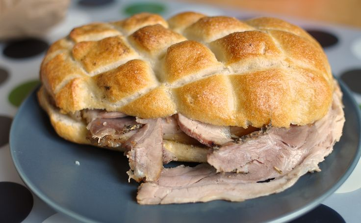 Panino con Porchetta Juicy roasted pork seasoned with salt, garlic, rosemary, and black pepper, served in a freshly baked baguette or grilled bread with different fillings.