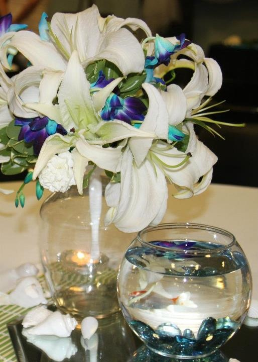 My wedding center pieces blue orchids white lilies fish