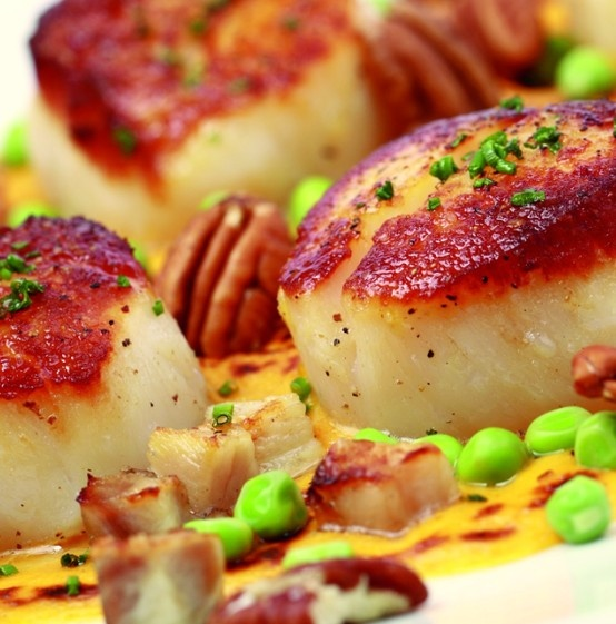 Scallops with pecans and porkbelly is one of the most popular southern-inspired entrees at Atlanta Grill.