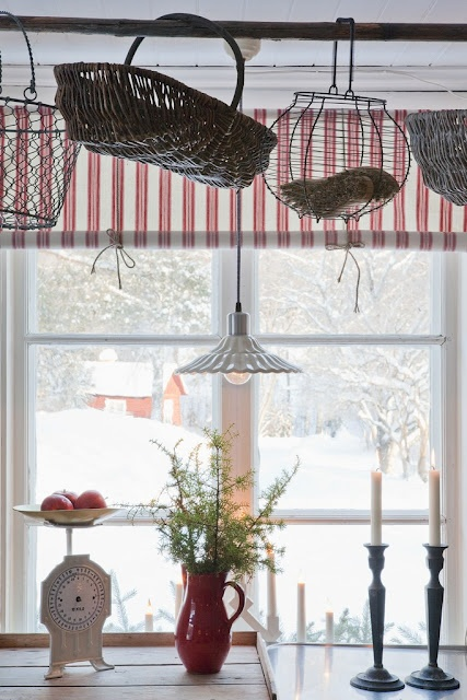 simple window treatment . . . hanging baskets on a curtain rod or pole of some sort