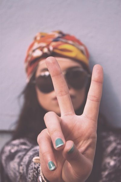 high school senior photography pose -peace sign and head scarf