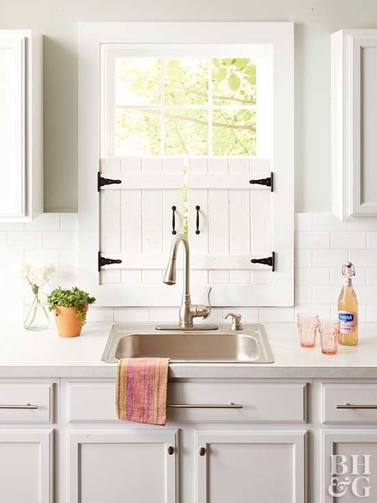 These adorable window shutters are perfect for a farmhouse kitchen—they offer privacy but still let in lots of light. Make them in a weekend with a few pieces of wood, some stain, and basic #DIY supplies. #farmhouseshutters #farmhousedecor #windowshutters