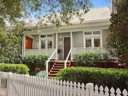 Weatherboard house with Wooden Picket Fence & Hedge