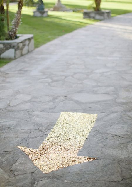 a gold sequined arrow shows party guests where to go {via 100 Layer Cake}