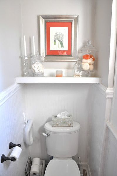 small gray and white toilet area with shelves and coral artwork… Small Bathroo…   – Wohnzimmer