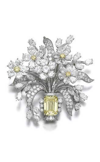 Fancy intense yellow diamond and diamond brooch, Bulgari, 1960s Of giardinetto design, the base set with a step-cut fancy intense yellow diamond weighing 3.00 carats, the leaves and petals decorated throughout with near colourless pear-, marquise-shaped, circular-cut and tapered baguette diamonds, four pistils set with circular-cut diamonds of yellow tints, case stamped Bulgari.