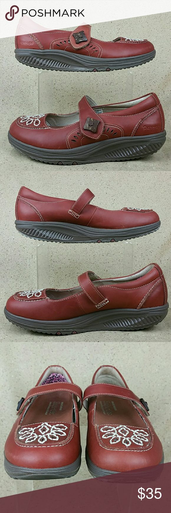 Skechers Shape-Ups Mary Janes Embroidered W 6 Skechers Shape-Ups 24883 These shoes are pre-owned in nice condition. Gentle wear on the outside from use includes scuffs. Little to no wear to the bottoms. Look over the pictures carefully before purchasing. Skechers Shape-Ups Shoes Flats & Loafers