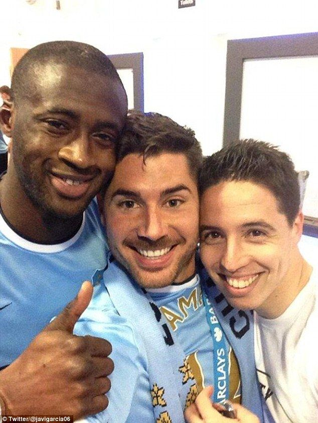 Thumbs up: Javi Garcia poses with Yaya Toure, Samir Nasri and some well-earned precious medal #PremierLeague2013/14