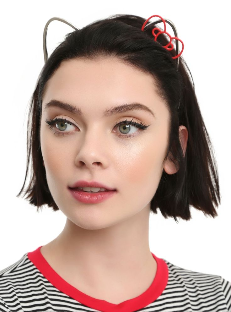 """Say hello to a chic <i>Hello Kitty</i> headband! The metal cat ears on a sleek metal headband include a cute red bow. Meow-velous.<div><br></div><div><ul><li style=""""list-style-position: inside !important; list-style-type: disc !important"""">Alloy</li><li style=""""list-style-position: inside !important; list-style-type: disc !important"""">Bow: 2"""" across</li><li style=""""..."""