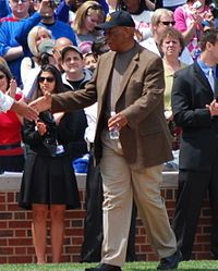 """Ernest """"Ernie"""" Banks, born 1/31/31 in Dallas, he entered Negro League baseball in 1950 and played for the Kansas City Monarchs.  He joined Major League Baseball (MLB) as shortstop and first baseman, playing for the Chicago Cubs between 1953 and 1971. He was an All-Star for 11 seasons, playing in 14 All-Star games.  He won back-to-back Most Valuable Player awards in 1958 & 1959, & led the league in HRs in 1958 & 60 and RBIs in 1958 & 1959."""