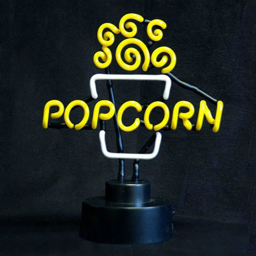 Neon Popcorn Topper - Neon Popcorn Sign This Sculptured Neon Sign is sure to draw attention and sales to any Popcorn Machine! Also looks great on a display shelf in a Home Theater! Adding the Popcorn Topper will create an exciting environment in your movie theater lobby, or any other place of business. Installs in just minutes: Simply set it on the popper and plug it in. Electrical: It comes complete with a 12-volt adapter, 6-foot cord and plugs into any standard 120-volt outlet while…