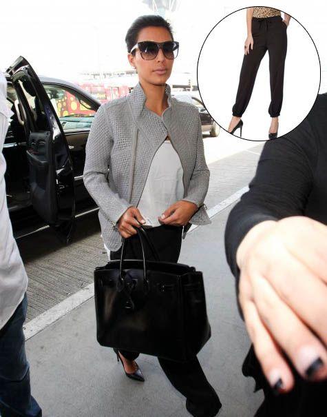 Kim rocking the Kardashian Kollection white tank and black pants