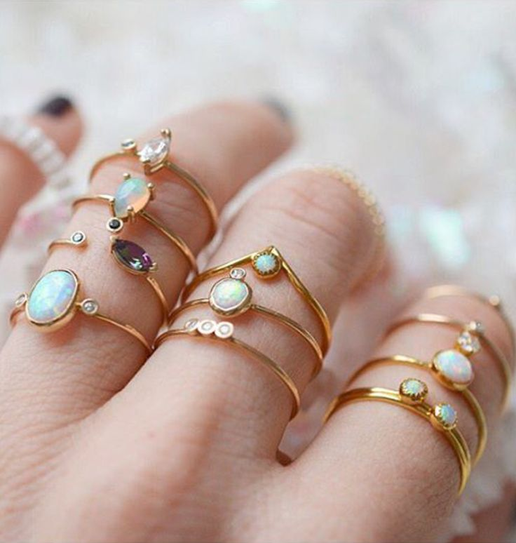 Opal Stacking Rings @lakaiserjewelry.. especially the wishbone one at the top of the ring finger