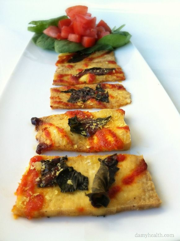 Spicy Basil Tofu Pizza Strips~ Ingredients: 1 Package Medium Firm Tofu, Olive Oil, Fresh Basil, Nutritional Yeast (Optional), Sriracha Hot Chili Sauce
