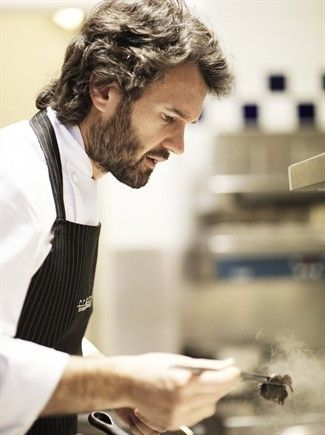 gotta love the face of a chef with the finishing touches of his masterpiece...