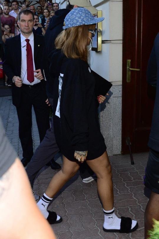 Rihanna wearing Puma Fenty Fur Slide Sandals in Black, Puma Heritage Crew Socks and Louis Vuitton Denim Monogram Cap