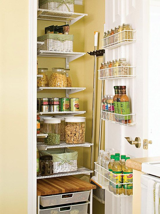 Instead of installing shelves from wall to wall, these shelves stop short, leaving room on the wall to mount a broom and mop holder. By sacrificing a just a few inches of shelf space, these cleaning necessities have a place to call home, and any storage space that was lost was regained by mounting basket-inspired shelves along the back of the door for condiments and spices.